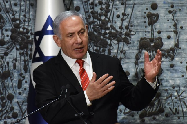Israeli Prime Minister Benjamin Netanyahu speaks to the media after President Reuven Rivlin gave him the mandate to form the next government at the president's residence in Jerusalem on Wednesday.  Photo by Debbie Hill/UPI