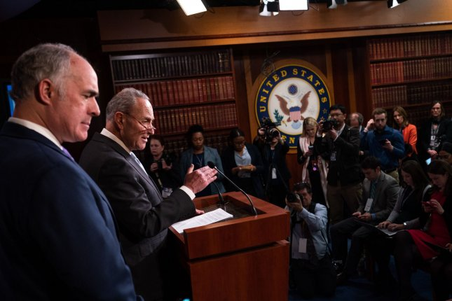Senate Democratic leader Charles Schumer and Sen. Bob Casey, D-Pa., (L) speak to reporters Thursday before the third day of President Donald Trump's impeachment trial in the Senate. Photo by Kevin Dietsch/UPI