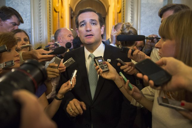 Sen. Ted Cruz (D-TX) speaks to the media after ending his nearly day-long filibuster like speech on Capitol Hill in Washington, D.C. on September 25, 2013. UPI/Kevin
