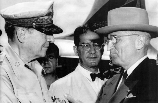 President Harry S.Truman (R) meets with Gen. Douglas MacArthur on Wake Island in the Pacific Oct. 14, 1950, to discuss U.S. policy in South Korea. Six months later, on April 11, 1951, Truman relieved MacArthur of his command in Korea. (The men in the background are not identified.) File Photo/UPI
