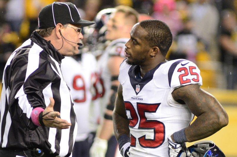 Houston Texans cornerback Kareem Jackson (25) talks to the official. UPI/Archie Carpenter