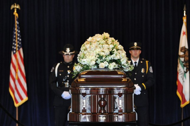 Mourners pay their respects as former first lady Nancy Reagan lies in repose at the Ronald Reagan Presidential Library and Museum, where she will be buried Friday. The public will be allowed to view the casket between 10 a.m. and 2 p.m. local time on Thursday. Pool photo by Jae C. Hong