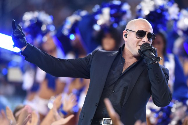 Pitbull performs during a Dallas Cowboys and Oakland Raiders game in 2014. File Photo by Ian Halperin/UPI