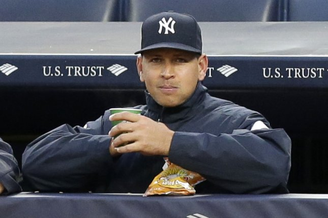New York Yankees' Alex Rodriguez watches the game from the dug out in the first inning against the Texas Rangers at Yankee Stadium in New York City on June 27, 2016. Photo by John Angelillo/UPI