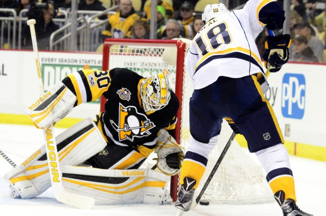 Pittsburgh Penguins goalie Matt Murray (30) protects the corner of the goal as Nashville Predators right wing James Neal (18) digs the puck out of the net during the third period. File photo by Archie Carpenter/UPI