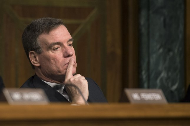 Senate intelligence committee Vice Chairman Mark Warner, D-Va., listens during a hearing on Russian meddling and influence into the 2016 presidential campaign on March 30. Warner on Sunday said he wants to question former FBI Director James Comey about whether President Donald Trump pressured him to drop an investigation. File Photo by Kevin Dietsch/UPI