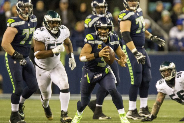 4df6b1937 Seattle Seahawks quarterback Russell Wilson (3) scrambles against the  Philadelphia Eagles during the second quarter on December 3