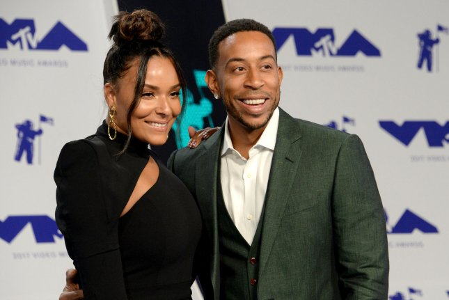 Eudoxie Mbouguiengue (L), pictured with Ludacris, went public about her miscarriage and resulting surgery in a post Monday. File Photo by Jim Ruymen/UPI