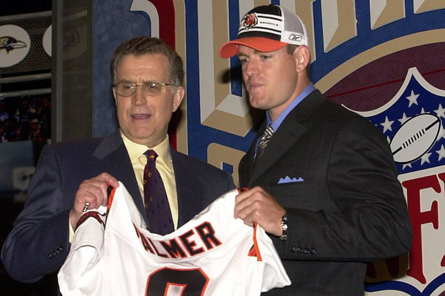 Former NFL Commissioner Paul Tagliabue (left) poses with No. 1 draft pick Carson Palmer -- quarterback from USC -- who was chosen by the Cincinnati Bengals at the 2003 NFL Draft held on April 24, 2003 at Madison Square Garden in New York. File photo by Ezio Petersen/UPI