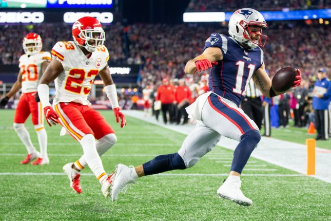 New England Patriots wide receiver Julian Edelman (11) leaps into the end zone on a 17-yard touchdown reception in the second quarter against the Kansas City Chiefs on October 14 at Gillette Stadium in Foxborough, Mass. Photo by Matthew Healey/UPI
