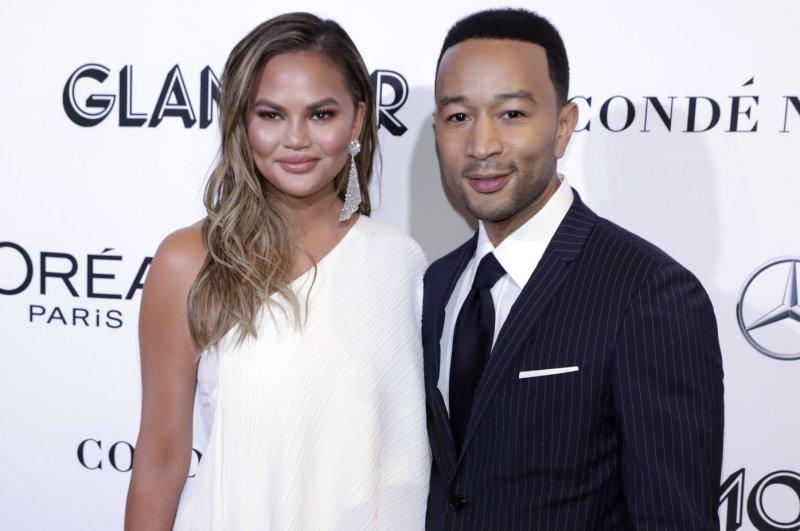 Chrissy Teigen (L) and John Legend attend the Glamour Women of the Year Awards on Monday. Photo by Jason Szenes/UPI