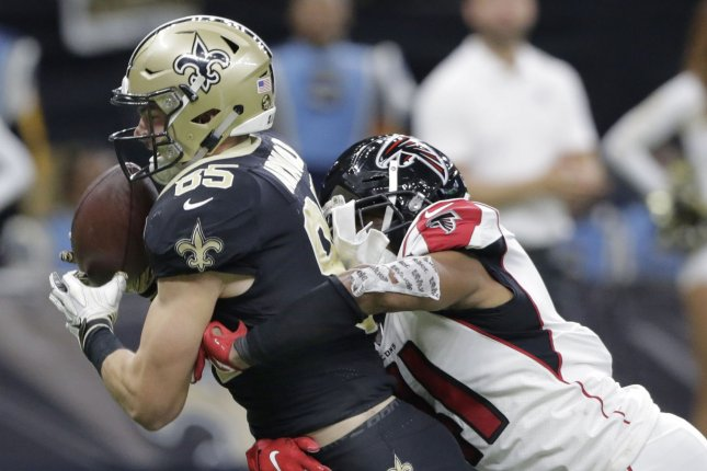 New Orleans Saints tight end Dan Arnold catches a Drew Brees pass in front of Atlanta Falcons defensive back Sharrod Neasman for a 25-yard touchdown in the third quarter at the Mercedes-Benz Superdome on Thursday night. Photo by AJ Sisco/UPI.