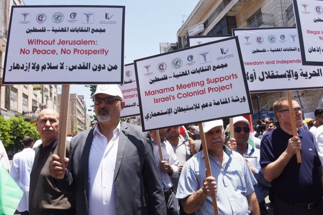 Palestinians demonstrate Monday in Ramallah, West Bank, against the Trump administration's Peace to Prosperity plan that launched Tuesday in Bahrain. Photo by Debbie Hill/UPI