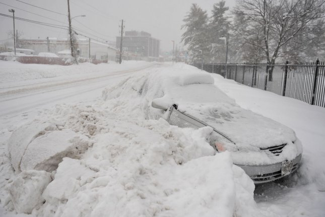 A snow-covered car is seen after Snowmageddon dumped 20-30 inches on the Washington, D.C., metro area on February 6, 2010. File Photo by Kevin Dietsch/UPI