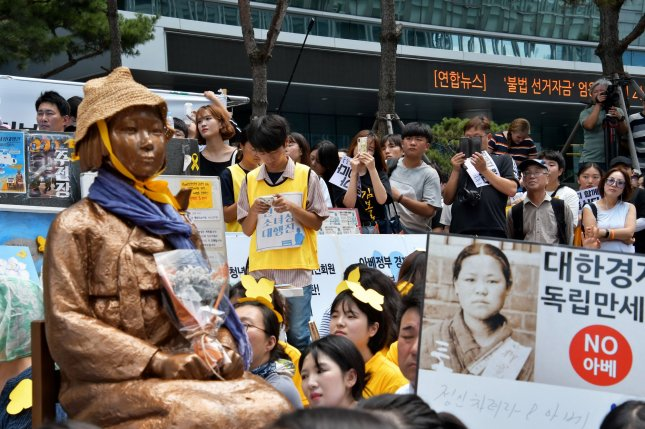 A Seoul court ruling on Friday ordered Tokyo to pay damages of over $91,000 each to 12 comfort women who were forced into brothels during World War II. Photo by Keizo Mori/UPI