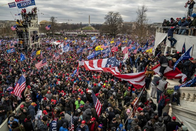 Pro-Trump rioters breach the security perimeter and penetrate the U.S. Capitol to protest against the Electoral College vote count that would certify President-elect Joe Biden as the winner in Washington, D.C. File Photo by Ken Cedeno/UPI