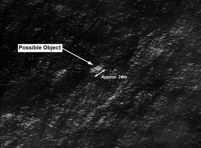 This satellite image released on March 20, 2014 by the Australian Maritime Safety Authority shows objects that may be possible debris of the missing Malaysia Airlines Flight MH370 in a revised area 185 km to the south east of the original search area. The imagery has been analyzed by specialists in Australian GeoSpacial-Intelligence Organisation and is considered to provide a possible sighting of objects that has resulted in a refinement of the search area. UPI/Australian Maritime Safety Authority