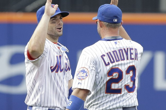 New York Mets David Wright and Michael Cuddyer celebrate after the game against the Boston Red Sox at Citi Field in New York City on August 30, 2015. The Mets defeated the Red Sox 5-4. Photo by John Angelillo/UPI