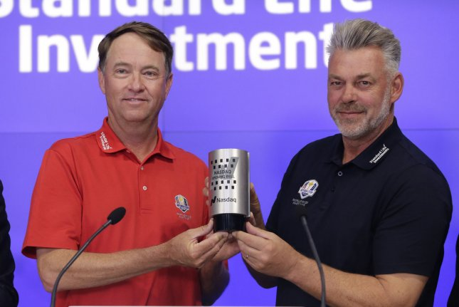 Ryder Cup Captains Davis Love III and Darren Clarke ring the opening bell at the Nasdaq in Times Square in New York City on April 28, 2016. Photo by John Angelillo/UPI