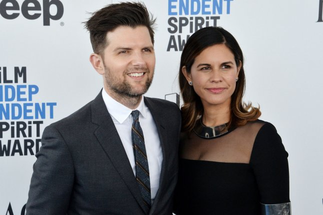 Adam Scott and his wife Naomi Scott attend the 32nd annual Film Independent Spirit Awards on February 25. Scott stars in the first trailer for Fox's Ghosted alongside Craig Robinson. File Photo by Jim Ruymen/UPI
