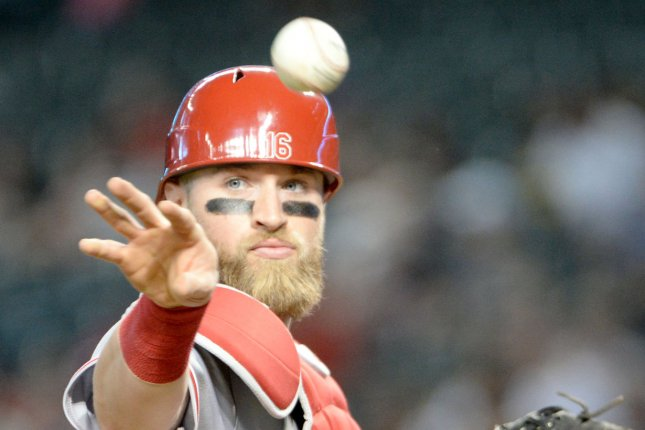 Cincinnati Reds' starting catcher Tucker Barnhart tosses a ball against the Arizona Diamondbacks on May 30 at Chase Field in Phoenix. Photo by Art Foxall/UPI