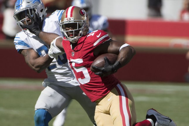San Francisco 49ers wide receiver Pierre Garcon (15) holds off Detroit Lions defensive back Quandre Diggs (28) on a 19-yard pass from Jimmy Garoppolo in the fourth quarter on September 16, 2018 at Levi's Stadium in Santa Clara, California. Photo by Terry Schmitt/UPI