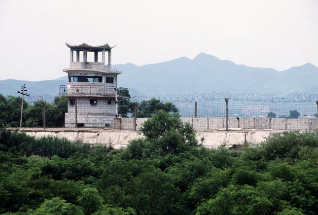 This Department of Defense photo show the concrete wall and barbed wire separating South Korea from North Korea Kijong-Dong Propaganda Village. (UPI Photo/Scott Stewart/USAF)