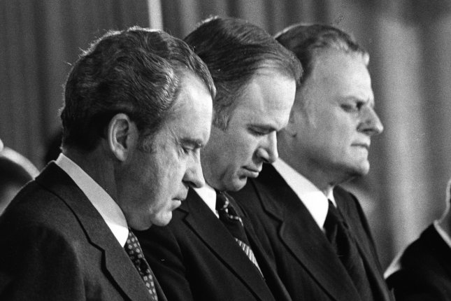 President Nixon bows his head during the closing prayer at the 21st annual National prayer breakfast at the Washington Hilton on February 1, 1973. (UPI Photo/rem/Files)