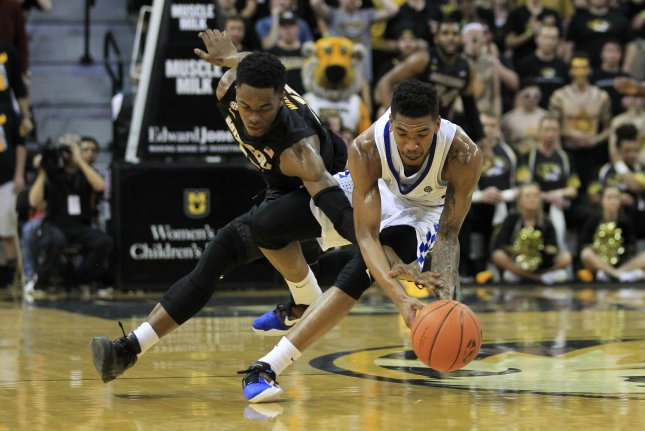 Missouri Tigers K.J. Walton (L) and Kentucky Wildcats Malik Monk battle for control in the first half at the Mizzou Arena in Columbia, Missouri on February 21, 2017. Photo by Bill Greenblatt/UPI