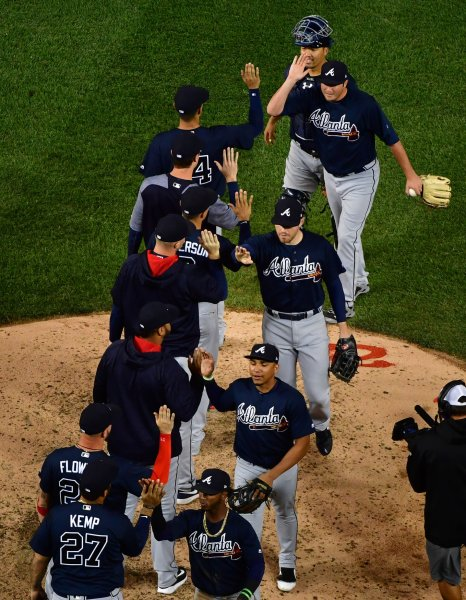 The Atlanta Braves celebrate their 8-0 win over the Washington Nationals at Nationals Park on Tuesday. Photo by Kevin Dietsch/UPI