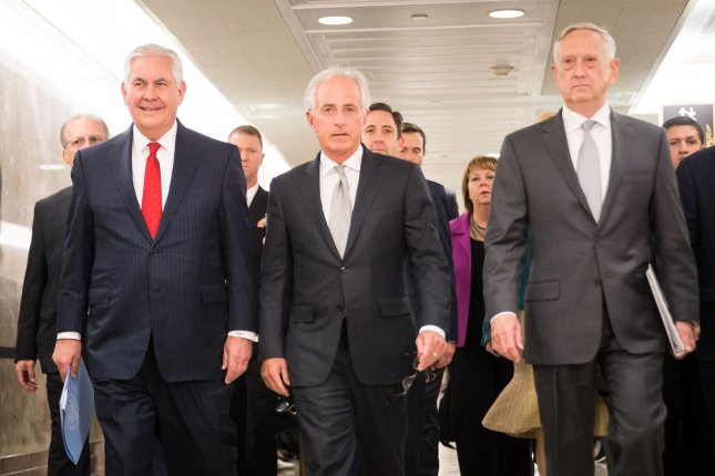 Secretary of State Rex Tillerson, Senate Foreign Relations Committee Chairman Sen. Bob Corker, R-Tenn., and Secretary of Defense Jim Mattis walk to a Senate Foreign Relations Committee hearing on Capitol Hill Monday. Photo by Erin Schaff/UPI