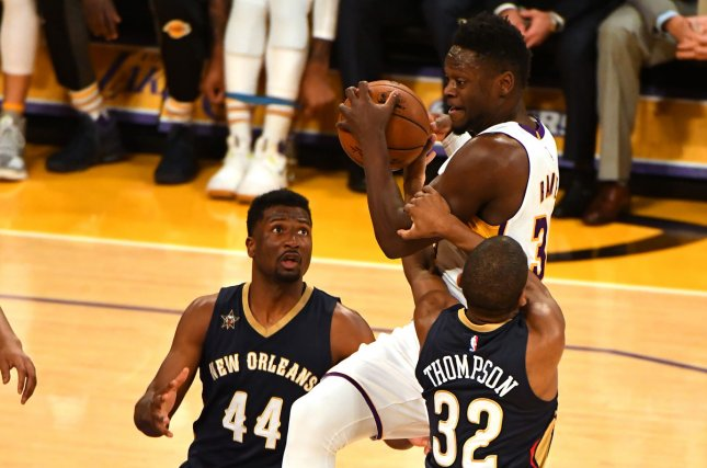 Los Angeles Lakers Julius Randle is fouled by Pelicans guard Hollis Thompson (32) at Staples Center in Los Angeles, March 5, 2017. File photo by Jon SooHoo/UPI