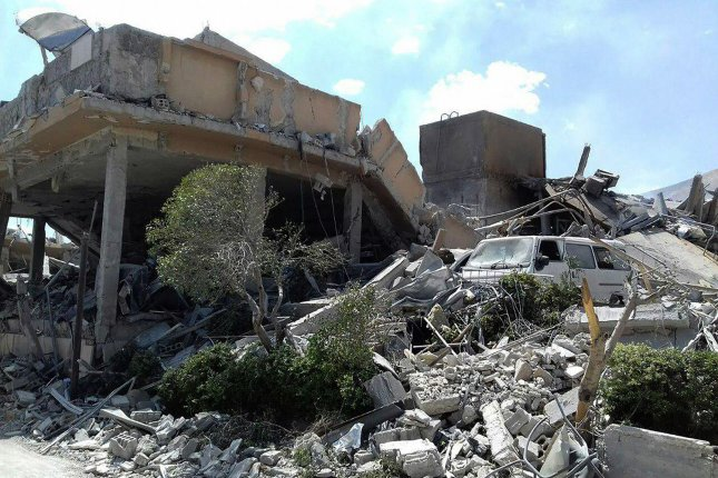 A photo released by Syria's government-owned news agency SANA shows the damage of the Syrian Scientific Research Center which was attacked by U.S., British and French military strikes to punish President Bashar Assad for suspected chemical attack against civilians, in Barzeh, near Damascus, Syria, April 14, 2018. Photo by SANA/UPI