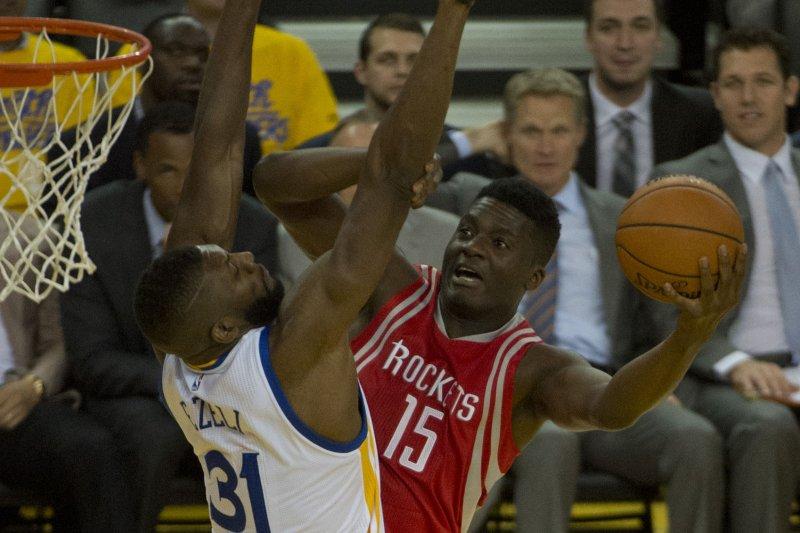 Houston Rockets center Clint Capela (15) tries to shoot over Golden State Warriors forward Festus Ezeli (31). File photo by Terry Schmitt/UPI