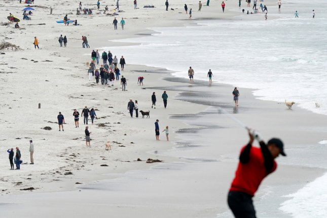 UPI photographer Kevin Deitsch won first place in the White House News Photographers Association 2020 Eyes of History contest for Sports Feature/Reaction for this photo of beachgoers as Tiger Woods hit from the ninth fairway in the final round of the 2019 U.S. Open at Pebble Beach Golf Links on June 16, 2019. Photo by Kevin Dietsch/UPI
