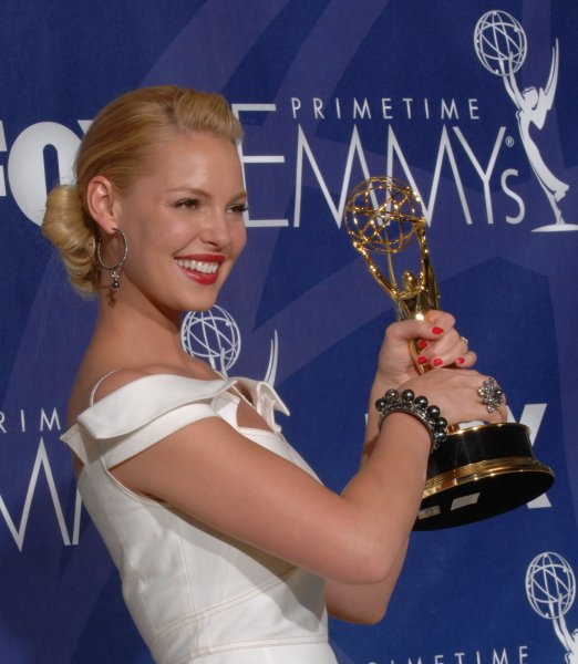 Actress Katherine Heigl displays her Emmy for work on 'Grey's Anatomy' at the 59th Primetime Emmy Awards at the Shrine Auditorium in Los Angeles on September 16, 2007. (UPI Photo/Scott Harms)