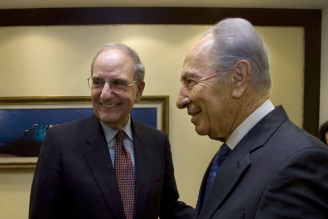 U.S. Middle East envoy George Mitchell (L) and Israeli President Shimon Peres meet at the President's residence in Jerusalem on January 28, 2009. Mitchell, President Barack Obama's new Mideast envoy, seeks to boost a 10-day-old cease-fire with Gaza that was broken after a Palestinian bombing killed an Israeli soldier. (UPI Photo/Sebastian Scheiner/Pool)