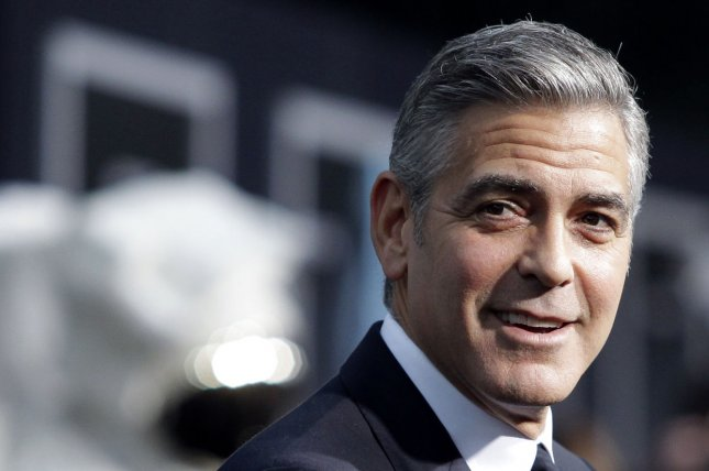 George Clooney arrives on the red carpet at the New York Premiere of Gravity at AMC Lincoln Square in New York City on October 1, 2013. UPI/John Angelillo