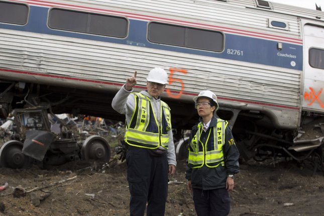 NTSB investigator Mike Flanigon briefs NTSB Vice Chairwoman T. Bella Dinh-Zarr on the scene of the Amtrak Train 188 derailment in Philadelphia. At least six people were killed and up to 200 hurt after the train, carrying 238 passengers and five crew members, derailed Tuesday. Photo by NTSB/UPI