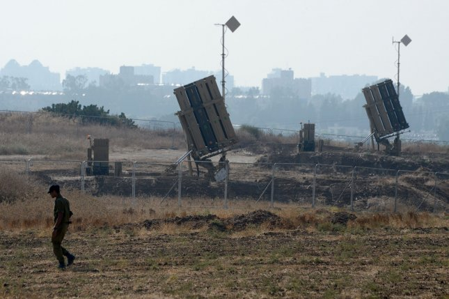 An Israeli soldier walks near an Iron Dome defense system that is used to intercept rockets from Gaza in Ashdod, Israel, July 21, 2014. One rocket fired from Gaza landed near Ashdod on Tuesday. Debbie Hill/UPI