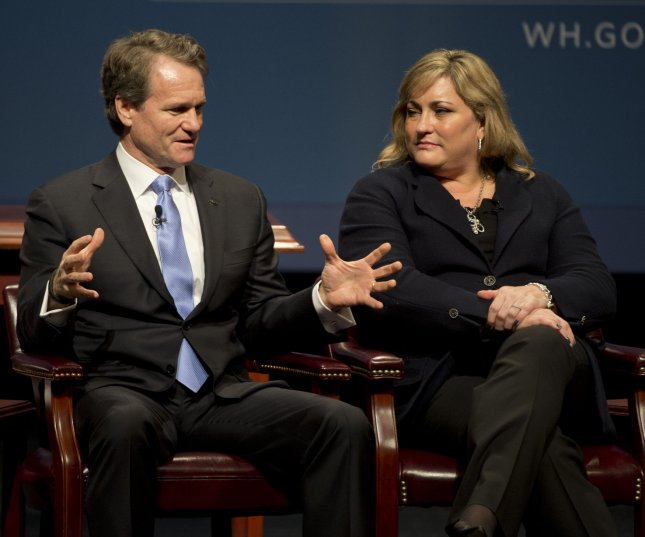 Bank of America CEO Brian Moynihan had his pay package increased to $16 million in 2015 after it had been reduced to $13 million the following year. The 23% increase represents the most Moynihan has been paid as CEO of the company. Above, he spoke to President of Intel Renee James (R) during a panel discussion at the Summit on Cybersecurity and Consumer Protection at Stanford University in Palo Alto, California on February 13, 2015. 