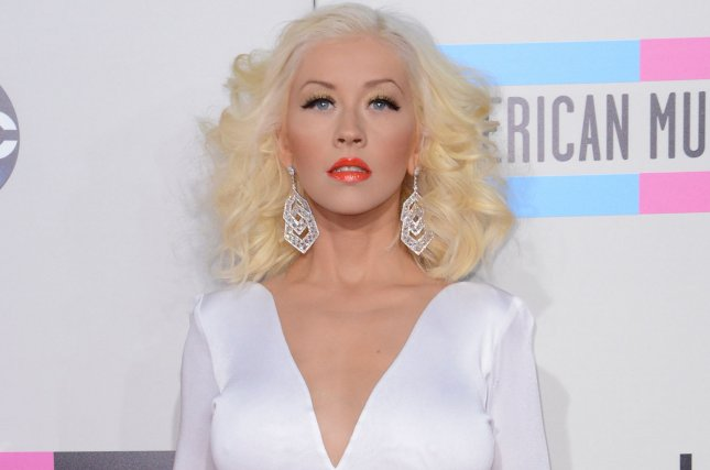 Singer Christina Aguilera arrives for the 41st annual American Music Awards held at Nokia Theatre L.A. Live in Los Angeles on November 24, 2013. File Photo by Phil McCarten/UPI