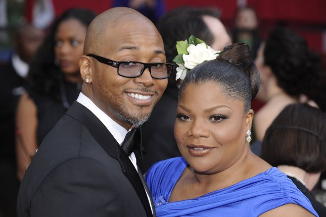 Mo'Nique (R) and Sidney Hicks at the Academy Awards on March 7, 2010. File Photo by Phil McCarten/UPI