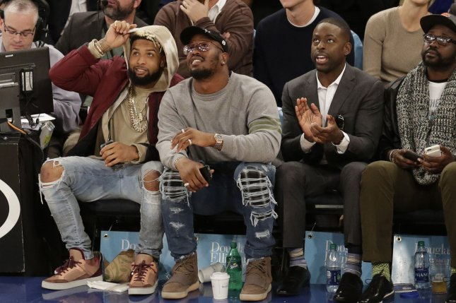 Odell Beckham Jr., Von Miller and Sterling K. Brown watch the New York Knicks play the Detroit Pistons on November 16 at Madison Square Garden in New York City. Photo by John Angelillo/UPI