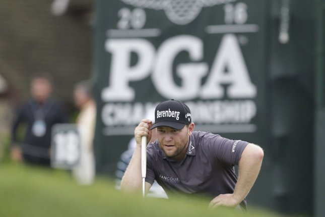 Branden Grace lines up a putt during the PGA Championship. Photo by John Angelillo/UPI