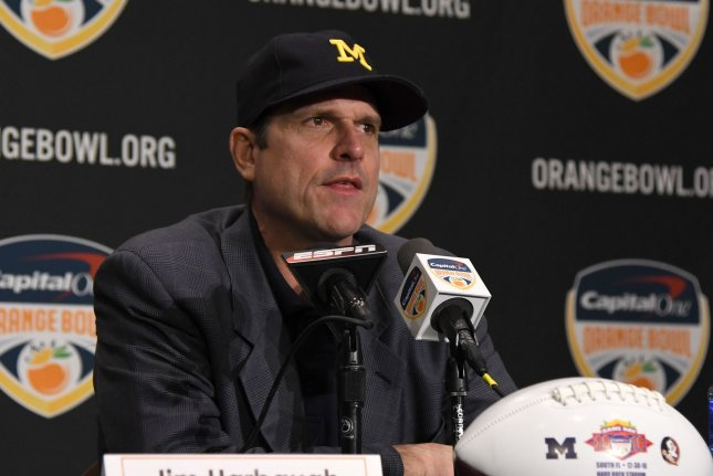 Michigan Wolverines Head Coach Jim Harbaugh answers questions from the media uring the Orange Bowl Head Coaches press conference at the Renaissance Fort Lauderdale Cruise Port hotel on December 29, 2016 in Fort Lauderdale, Florida. The Orange Bowl game will be played Friday, December 30, 2016 at the Hard Rock Stadium in Miami, Florida. Photo by Gary I Rothstein/UPI