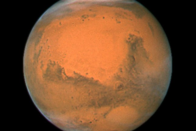 New research suggests microbial communities can survive the harsh conditions found on the surface of Mars. Photo by UPI Photo/NASA/ESA/Hubble Heritage Team