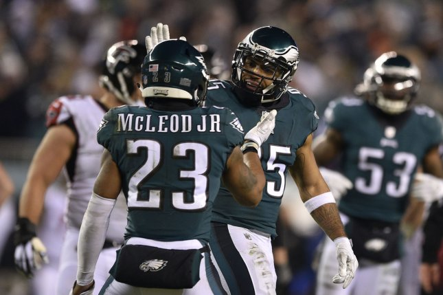 Philadelphia Eagles' Rodney McLeod (23) celebrates with Mychal Kendricks (95) after a sack during the third quarter of an NFC divisional playoff game against the Atlanta Falcons on December 31 at Lincoln Financial Field in Philadelphia. Photo by Derik Hamilton/UPI