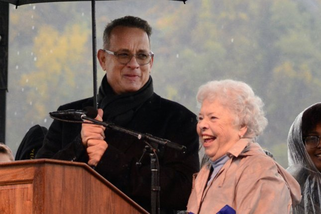 Tom Hanks (L) and Joanne Rogers attended the Rally for Peace in Pittsburgh in 2018. Rogers died Thursday at the age of 92. File Photo by Archie Carpenter/UPI
