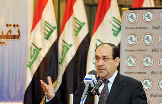 Iraq's Prime Minister Nouri al-Maliki (C) speaks at a conference at the Iraqi Defense Ministry headquarters in Baghdad, Iraq on March 31, 2010. UPI/Ali Jasim